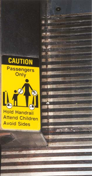 Hold Children. Avoid accidents. Love handrails. Avoid children. Hand over rails. Avoid handrails. Hand over children. A side of children, hold the love. Yellow and black passengers only.